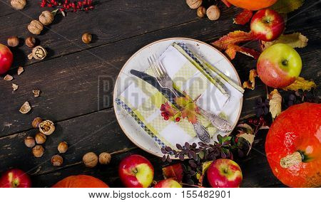 Autumn Pumpkins, Apples  And Nuts On  Rustic Wooden Background.