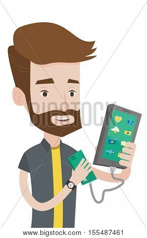Smiling hipster man recharging his smartphone with mobile phone portable battery. Young man holding a mobile phone and portable battery. Vector flat design illustration isolated on white background.