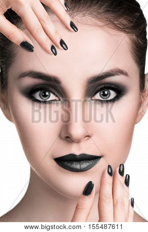 Young beautiful woman with smoky eyes makeup over white background