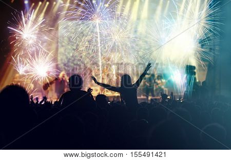 Fireworks and crowd celebrating the New Year