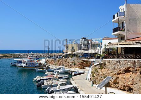 SISSI, CRETE - SEPTEMBER 14, 2016 - Boats moored in the harbour with waterfront restaurants to the right hand side Sissi Crete Greece Europe, September 14, 2016.