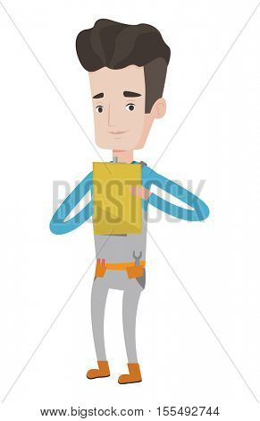 Caucasian young plumber making some notes in his clipboard. Smiling male plumber at work. Happy plumber in overalls holding clipboard. Vector flat design illustration isolated on white background.