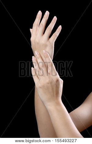 beautiful young hands woman isolated on black background