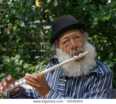 Old African American Musician Playing Flute