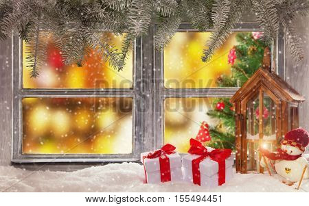 Vintage wooden window overlook home interior with christmas tree. Decoration on foreground