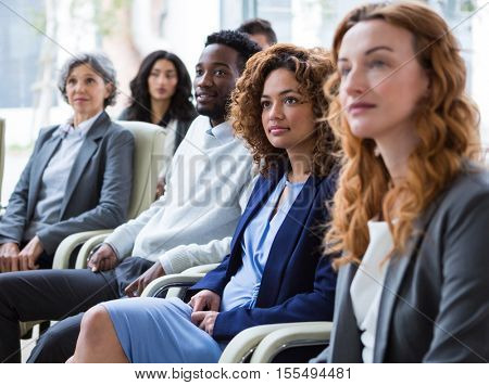 Attentive businesspeople in meeting at office