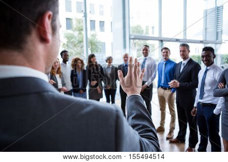 Businessman interacting with colleagues in office