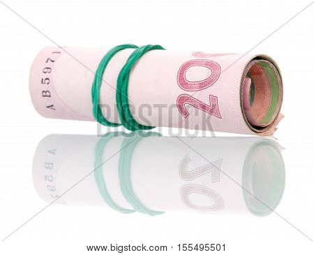 Ukrainian money in a roll isolated on white background.