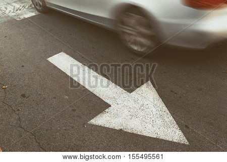 Driving car in wrong direction against arrow sign forbidden behavior in traffic making offence