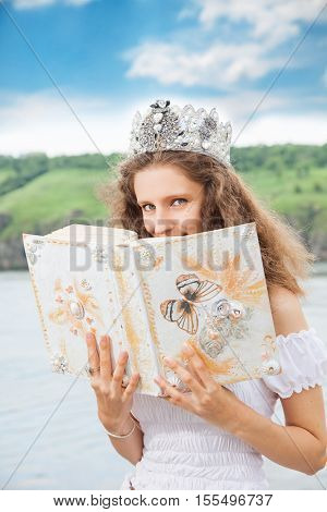 woman with book in hands. outdoor shot