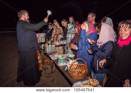 Happy People During A Night Service. Dobrush, Belarus