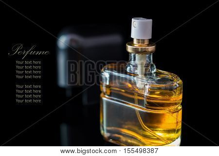 Perfume Bottle Isolated On Black Background With Reflexion.