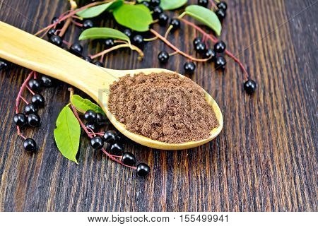 Flour Bird Cherry In Spoon With Berries On Wooden Board