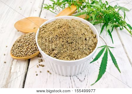 Flour Hemp In Bowl With Spoons On Light Board