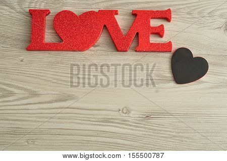 Valentine's Day. Love in red letters with a small black heart