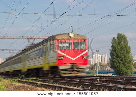 Several carriages of fast moving urban electric multiple unit blurred in motion