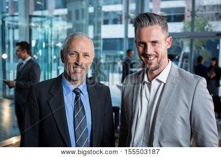 Portrait of smiling businessmen in office