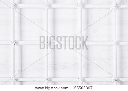 Soft white background with lattice. Wooden board.