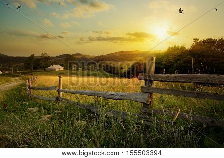 countryside landscape; rural farm and farmland field