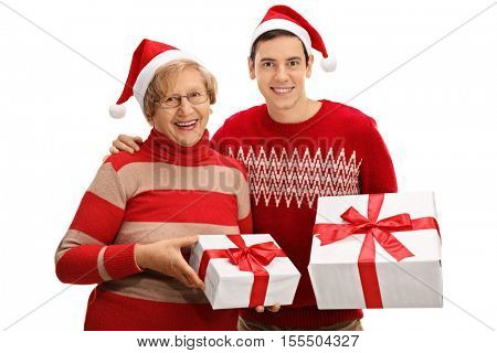 Senior and young man with christmas presents isolated on white background