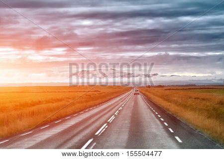 Empty road leading to snow covered mountains, Beautiful landscape in early autumn of Iceland