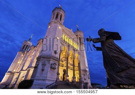 Basilica of Notre-Dame de Fourviere in Lyon and Pope John Paul II statue. Lyon Rhone-Alpes France.