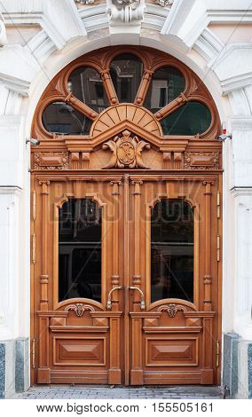 old wooden Front Door of a Traditional European Town House.