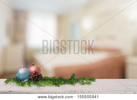 christmas decoration on old white wooden table in the bedroom
