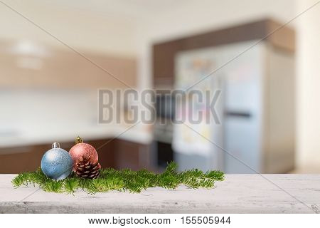 christmas decoration on old white wooden table in the kitchen