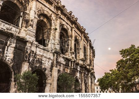 Arena of Nimes at sunrise and moonset. Nimes Occitanie France.