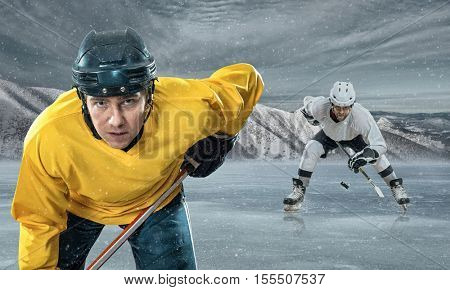 Ice hockey players on the ice in mountains