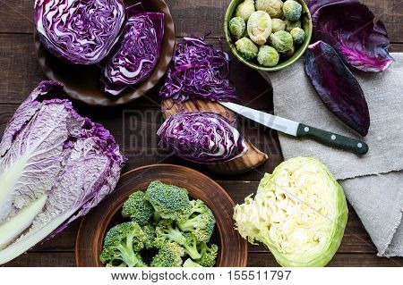 Many kinds of cabbage - red broccoli Brussels sprouts white napa cabbage. Ingredients for the preparation of vegetable dishes. The top view.