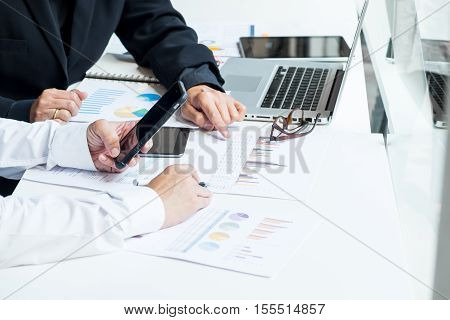 Business Documents On Office Table With Smart Phone And Laptop Computer And Graph Financial With Soc