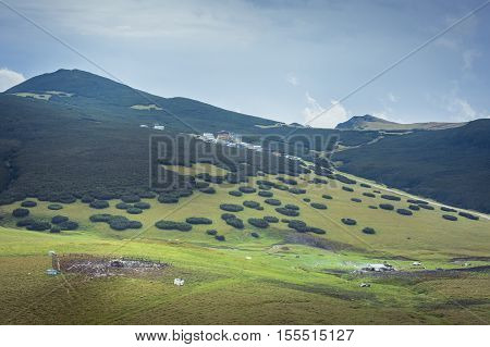Scenic Mountain Landscape With Clouds Rising Over The Surface Of