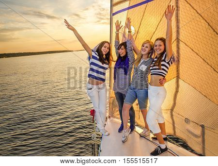 Holiday on a sailing yacht. Smiling girls on yacht. Living a happy life.