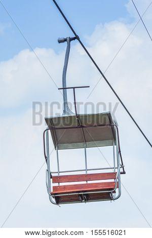 Chairlift ski. Empty Chairlift at a ski resort. Chairlift ski over blue sky.