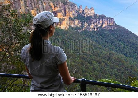 Woman Looks At The Landscape Of The Three Sisters Rock Formation In The Blue Mountains Of New South