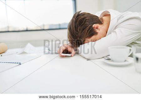 Overtime and burnout of businessman sleeping on desk