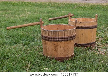 Two Wooden Pails On Meadow