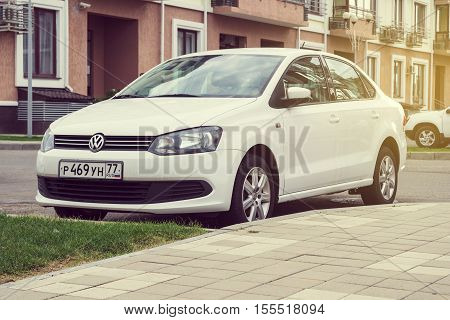 Sochi, Russia - October 11, 2016: New white Volkswagen Polo parked on the street of Sochi.