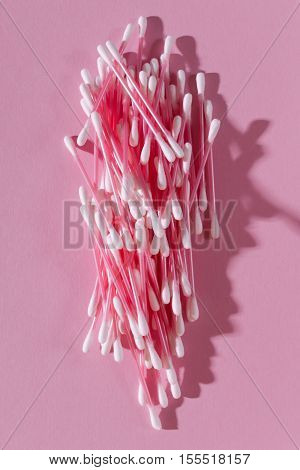 Bunch Of Cotton Swabs On A Pink Background Closeup