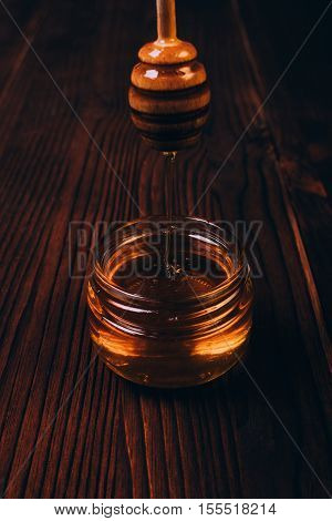 Vertical Frame Honey Dripping Into Jar On A Table