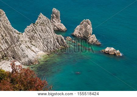 Beautiful view of Two Sister (Due Sorelle) bay , Conero Mountain in the adriatic sea, Italy