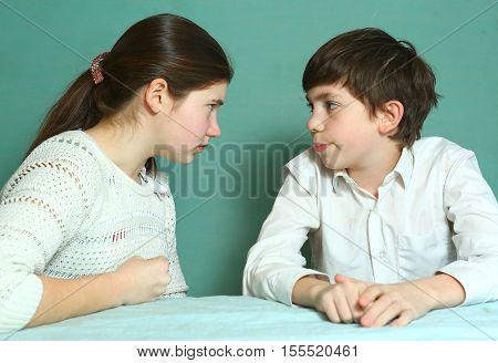 eurpean siblings brother and sister quarelling close up photo
