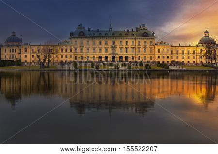 Sunset over the royal Drottningholm palace in Stockholm Sweden. The Drottningholm Palace is the private residence of the Swedish royal family.