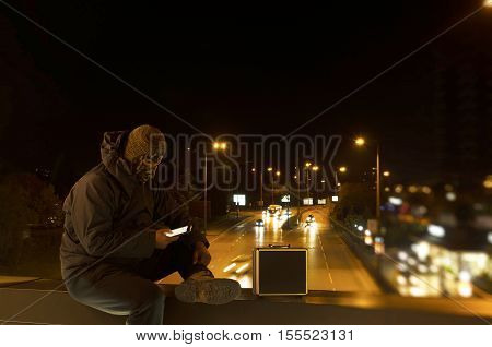Terrorist on a bridge with suitcase. Night shot. Long exposure