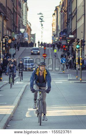 Stockholm Sweden - April 01 2016: Bikers on streetin Stockholm city. People in Stockholm.Tourists in Old Town Stockholm city Sweden