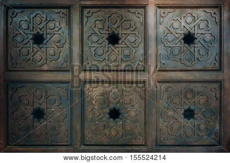 Vintage old brown wood door with patterns