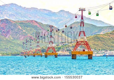 Nha Trang, Vietnam - July 29th, 2016: Cable car to Vinpearl amusement park in the morning sunshine to attract tourists to the weekend relaxing in Nha Trang, Vietnam
