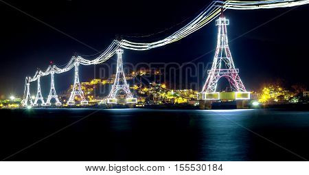 Night cable car over sea leading to Vinpearl land, Nha Trang, Vietnam.